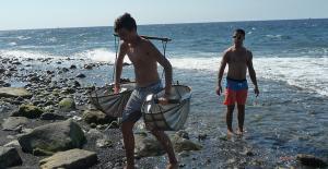 BIS students hauling seawater to make salt the old way